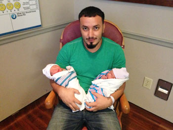 Cristian Zuniga pictured with son Cristian Jr. (left) and daughter April (right)