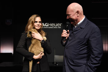 Model Cara Delevingne (L) poses with Jean-Claude Biver (R)