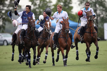 Royal Salute World Polo Ambassador Malcolm Borwick, Prince Harry, and Argentine player Nacho Figueras compete during the Sentebale Royal Salute Polo Cup in Palm Beach at Valiente Polo Farm on May 4, 2016 in Palm Beach, United. The event will raise money for Prince Harry's charity Sentebale, which supports vulnerable children and young people living with HIV in Lesotho in southern Africa.  (Photo by Chris Jackson/Getty Images for Royal Salute)